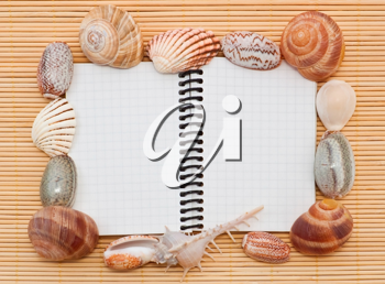 Sea tematic spiral notebook on wooden background