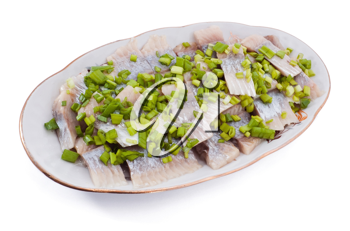 Herring with cut onion on the plate