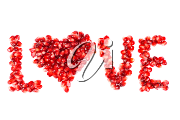 Royalty Free Photo of Pomegranate Berries Spelling the Word Love With a Heart