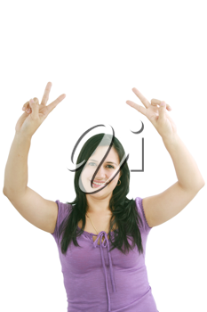 beautiful smiling woman making victory sign with both of her hands, smiling and looking into the camera