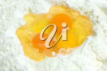 Royalty Free Photo of Eggs on Flour