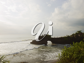 View on ocean coast at Tanah Lot area at sunset, Bali, Indonesia