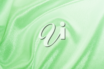 Abstract background green silk fabric with beautiful waves