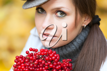Royalty Free Photo of a Woman Holding Viburnum Berries