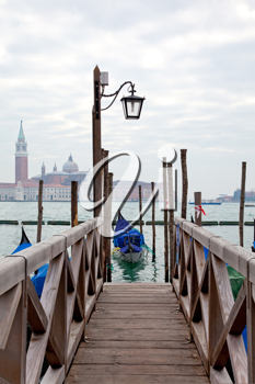 Royalty Free Photo of a Gondola at a Pier in Venice