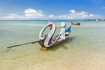 Royalty Free Photo of a Long Thai Boat on a Beach, Koh Samui, Thailand