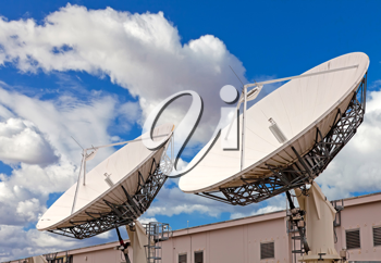 Royalty Free Photo of Satellite TV Antennas on the Roof of a Communication Center