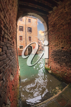 Tunnel to the channel with stairs and bridges in Venice, Italy