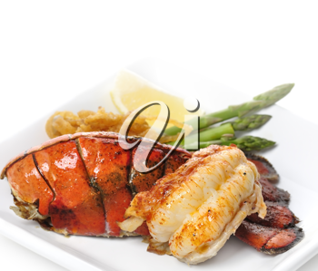 Royalty Free Photo of a Grilled Lobster Tail With Asparagus and Onions