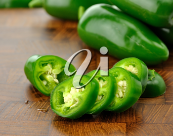 Royalty Free Photo of a Hot Pepper on a Cutting Board