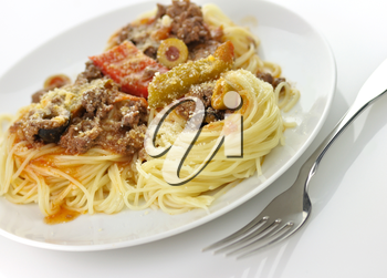 pasta nests with meat and vegetables in a white plate
