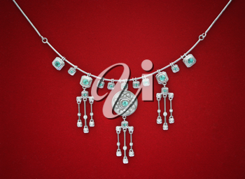 Diamond necklace on the red fabric background, macro