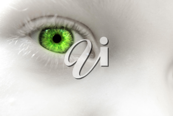 A child with green eyes close up