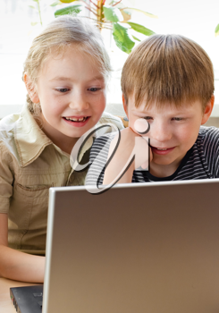 Royalty Free Photo of Two Children With a Laptop