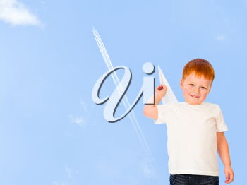 Royalty Free Photo of a Boy With a Paper Airplane