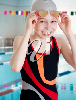 Royalty Free Photo of a Girl Beside a Swimming Pool