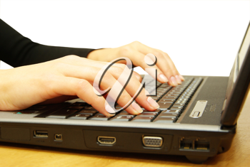 Royalty Free Photo of a Woman Using a Laptop