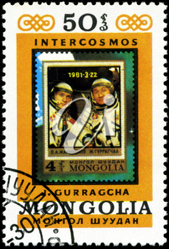 MONGOLIA - CIRCA 1981: A stamp printed in Mongolia showing stamp with cosmonaut B.  Dzhanibekov and J.Gurragchaa, circa 1981