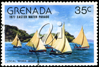 GRENADA - CIRCA 1977: A stamp printed in Grenada issued for the easter water parade  shows local work boat races, circa 1977.