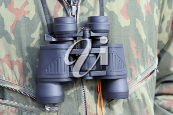 Army and people concept, black binocular hanging on his chest military officer.