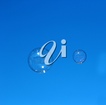 Soap bubble flying against the blue sky.