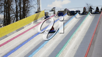 MOSCOW - JANUARY 16: ice slide, tubing, winter on January 16, 2018 in Moscow, Russia.