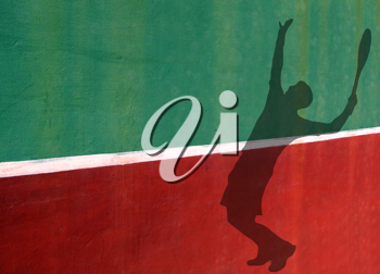 Royalty Free Photo of a Silhouette of Tennis Player Serving
