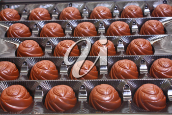 much black chocolate candy in box row