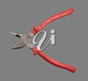red pliers on a gray background