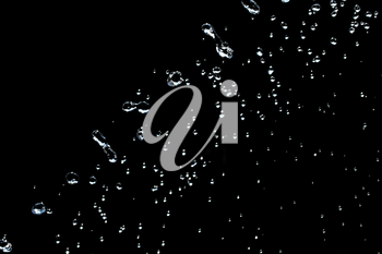 water on a black background