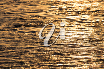 Background of the water surface at sunset