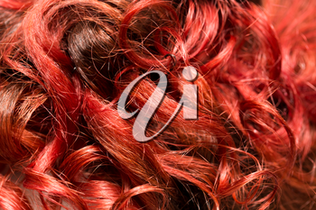background of red wavy hair