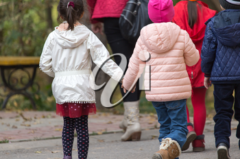 children in the park for a walk