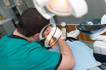 The dentist works with the client in the clinic .