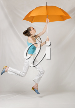 Beauty girl jump with orange umbrella