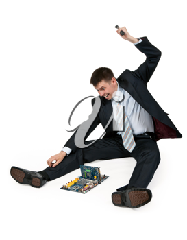 Royalty Free Photo of a Businessman Breaking a Computer With a Hammer