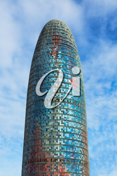 Barcelona, Catalonia, Spain - January 28, 2014: Vertical view of the Agbar Tower (Torre Agbar), a 38-story skyscraper, and one of the main samples of High-Tech architecture in Barcelona city. Agbar To
