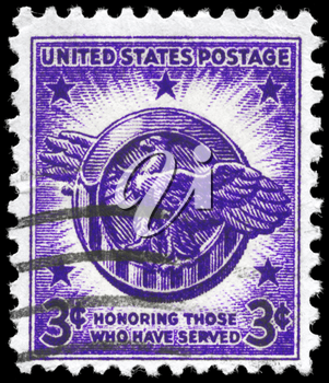 Royalty Free Photo of a 1946 US Stamp Showing an Honorable Discharge Emblem, Veterans of World War II Issue