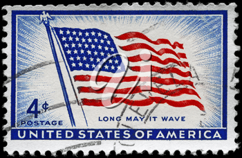Royalty Free Photo of 1957 US Stamps Shows the Flag Old Glory with the Inscription Long May It Wave