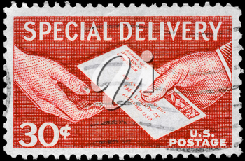 Royalty Free Photo of 1957 US Stamp Shows the Special Delivery Letter, Hand to Hand