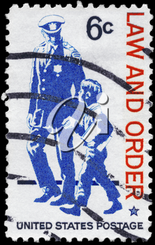 Royalty Free Photo of 1968 US Stamp Shows Policeman and Small Boy, Law and Order Issue
