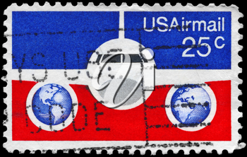 Royalty Free Photo of 1976 US Stamp Shows the Plane and Globes