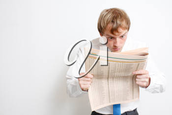 Royalty Free Photo of a Businessman Reading the Newspaper