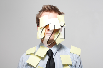 Royalty Free Photo of a Man Covered in Notes