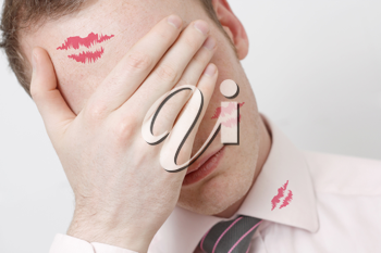 Royalty Free Photo of a Businessman With Lipstick Marks