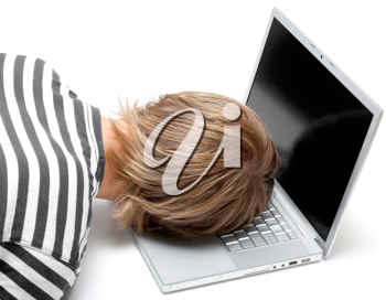 Royalty Free Photo of a Man Sleeping on a Laptop