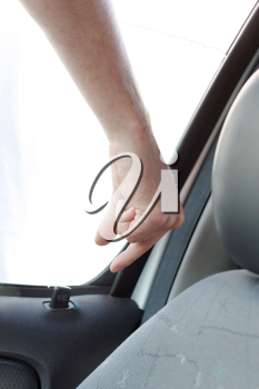 Royalty Free Photo of a Person Unlocking a Car Door