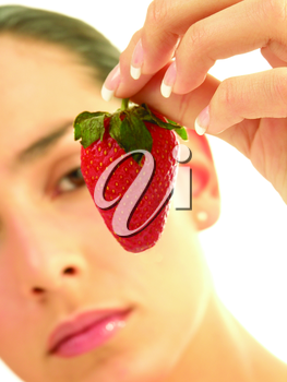 Royalty Free Photo of a Woman Looking at a Strawberry