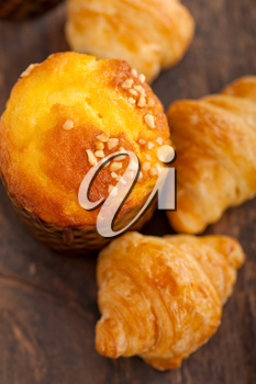 fresh baked muffin  and croissant mignon on old wood table
