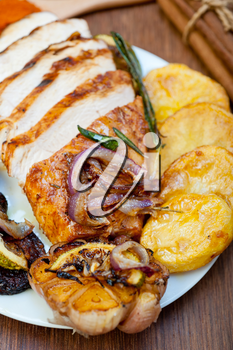 roasted grilled BBQ chicken breast with herbs and spices rustic style